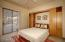 Fourth bedroom has its own private bathroom and a Murphy Bed that allows for desired extra space. Bathroom has access to the pool.