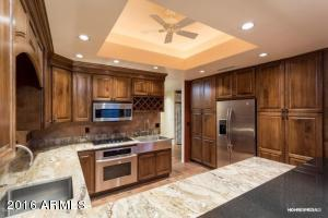 Private Chef designed the gourmet kitchen~pantry rolling shelves & custom buffet for entertaining needs.