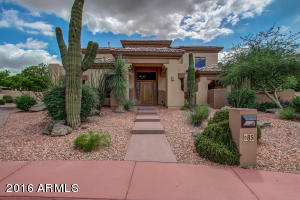 Gorgeous custom home on large lot in a beautiful custom and gated community