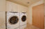 This large laundry room has lots of cabinets