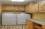 Laundry room has alder cabinets & tons of storage