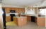 Honey Maple Cabinets, Light Neutral Non-Laminate Counters