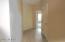 Neutral Paint, Large Tile, Closets in Hallway