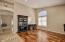 Beautiful flooring- engendered wood flooring in living/dining rooms