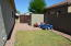 another side yard with RV gate and storage shed