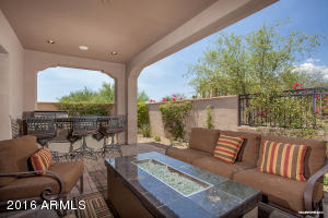 Great outdoor living with spacious covered patio and fire table