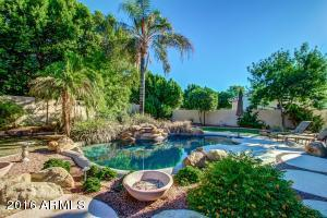 Sparkling pool, lush landscaping Built in BBQ & Covered Patio +++
