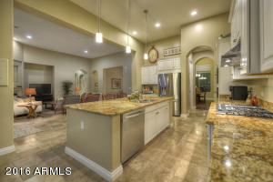 Welcome to a Truly Stunning, Open Floor Plan concept in this LIKE-NEW Meritage home! Dramatic, GORGEOUS Kitchen embraces the Family Rm, Den/Sitting Rm, and Morning Rm; then, reaches lazily out to the backyard wonderland through multiple sliding glass doors for an extended al fresco experience.