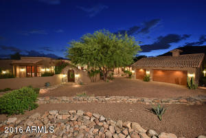 The home is situated on a corner lot with incredible curb appeal, a gated courtyard and a multiple car motor court.
