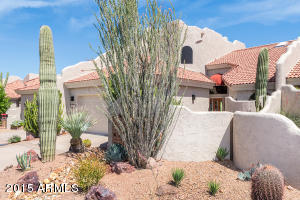 Gorgeous Desert Landscaping enhances the front of the property. Note the walled (and gated) Front Courtyard.