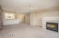 Open floor plan with great room and formal dining connected.