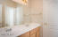 Both secondary bedrooms have access to this bathroom which features dual vanities.