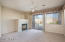 Great room offers a gas fireplace and sliding glass door to pool/patio.