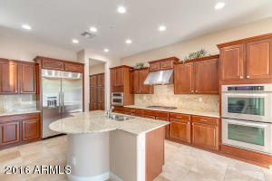 Kitchen with built-in refrigerator, double ovens and microwave/convection oven
