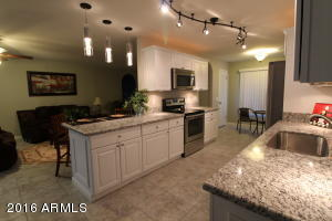 View of kitchen w/ALL lights on - kitchen has automated lighting for easy convenience