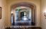 Lustrous walnut plank wood floors with stone detail inlay beneath the arches.