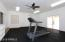 This Fitness Room Adjoins Garage and Ideal Also for Theater or Hobby or Office!