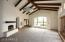 Great Room/Living Room with See Through Two Way Fireplace to Kitchen Area and Views to the City below.