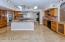 Granite w/ marble & pewter accent backsplash, stainless Dacor appliances, Sub-zero refrigerator, island w/ 5 burner cooktop