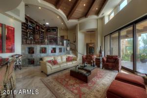 The open floor plan has special features everywhere you look from the custom ceiling treatments to the stone accents and telescoping doors to bring the outside in.