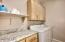 Over Sized Laundry Room has Extra Storage & Work Space