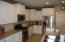 Beautifully appointed Kitchen w/Granite and SS appliances