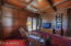 Rich Mahogany paneling, ceiling detailing and built in library