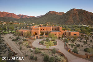 Magnificent estate nestled on 5.7 acres with endless mountain and city views.