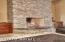 GAS FIREPLACE, LEATHER GRANITE SEATING ON HEARTH.