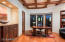 Hickory Floors and Mahogany Built-in Cabinetry accent this warm office with private patio