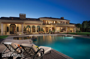 The home's timeless design exudes a warm inviting European country feel. All the rooms open onto one of the estates many terraces, engaging you in Arizona's inviting year round climate on this private 4.39 acre estate.