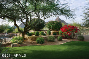 Located on a signature double fairway in the guard gated community of Desert Highlands.