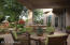 The deep covered patio wraps the home and creates a variety of conversation and dining areas.