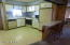 Kitchen with breakfast bar on right
