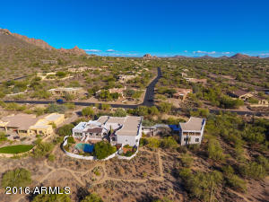 TO THIS SPRAWLING PRIVATE COMPOUND ON 1.6 ACRES WITH ENDLESS VIEWS