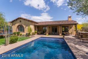 Resort like backyard with pool, built-in BBQ, grassy play area, covered patio on a highly desirable corner lot with privacy and mountain views.
