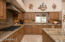 Gourmet Kitchen with Granite, Stainless and Gas Cooktop