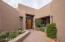 Entry with mature Sonoran Desert landscaping