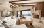 Electric telescoping doors open living room to outdoor living