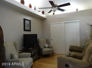 The 3rd bedroom has hard wood flooring, lighted plant shelves, ceiling fan w/light kit. Room may also be used as a den.