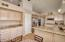 Large kitchen offers plenty of counter space and cabinetry, there is even a walk-in pantry