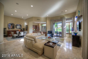 Great Room open to Dining, Kitchen and covered patio overlooking grassy area