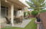 All Patio Furniture stays. An extended patio cover was added as well as a roll down sun shade.