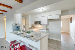 Large granite island, stainless steel appliances to be installed.