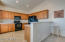 Kitchen complete with a pantry and breakfast bar