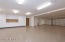 Fits 6+ vehicles plus plenty of storage cabinetry & workbench. Door leads to elevator & exercise room/workshop foyer