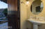 Lovely pool bath w/arched entry directly adjacent to Pool & Spa!