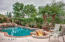 Gas fire pit over looking pool. Perfectly situated trees and landscaping for privacy.