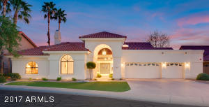 Exceptional Home with impressive curb appeal located on a quiet street.