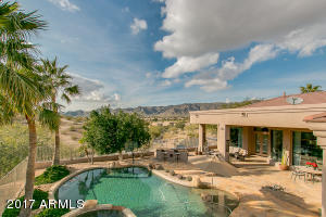 This photo sets the stage for this spectacular VIEW property. South Mountain and Estrella range in the distance.